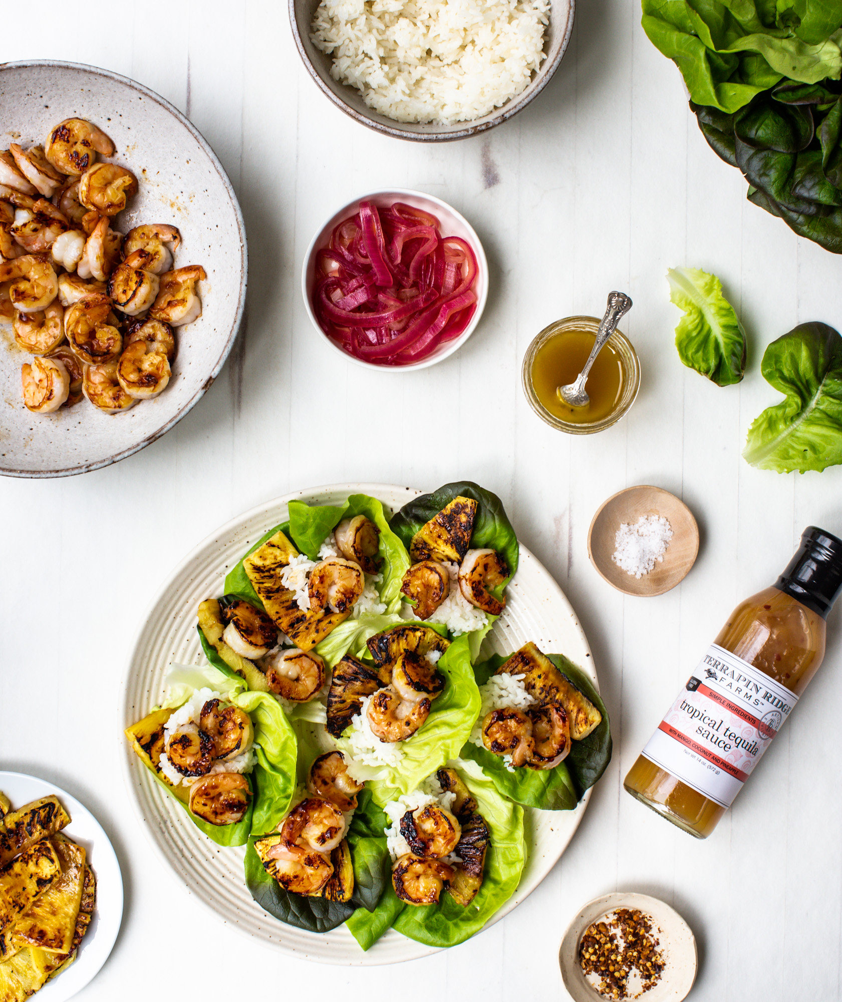 Tropical Lettuce Wraps with Shrimp, Pineapple, and Pickled Red Onions.