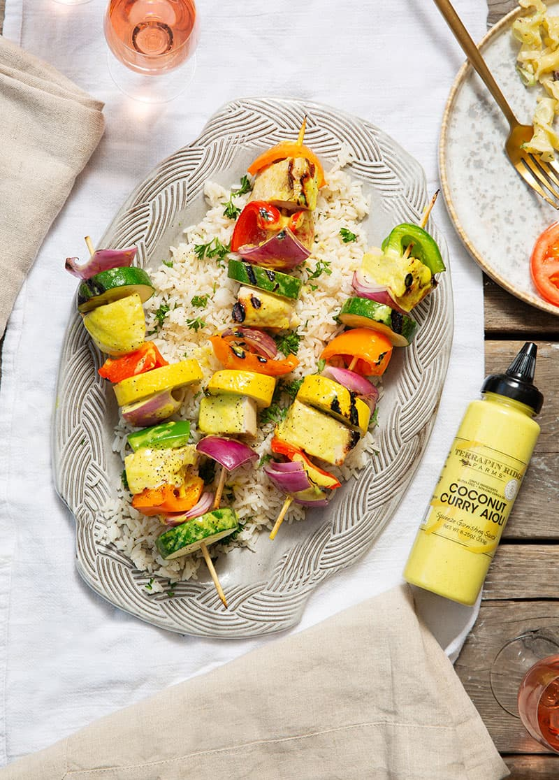 Coconut Curry Aioli Chicken Kebabs over bed of rice